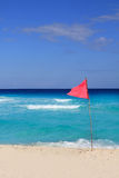 Dangerous red flag in beach rough sea signal Royalty Free Stock Photo