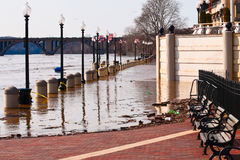 Dangerous river flood. Potomac River in flood. Urban area insurance risk. Washington Harbor, Georgetown waterfront, Washington DC, USA Stock Image