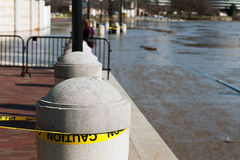 Dangerous river flood at harbor. Potomac River in flood. Urban area insurance risk. Washington Harbor, Georgetown waterfront, Washington DC, USA Stock Photography