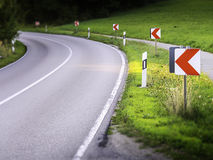 Dangerous road curve. With warning signs Stock Photography