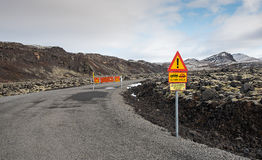 Dangerous road driving. Dangerous countryside road with Sings warning drivers for the danger of off-road driving in Iceland stock images