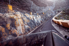 Dangerous road with landslide Stock Images