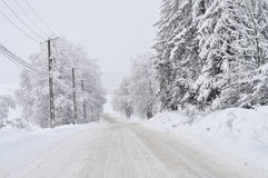 Dangerous road. Dangerous slippery road covered with snow and ice Stock Image