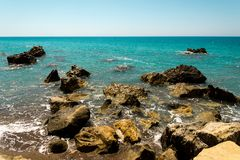 Dangerous rocks and reefs near beach in Pissouri bay, Cyprus Stock Image