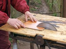 Dangerous sawing. Sawing on the circular saw, without safety tools Royalty Free Stock Photo