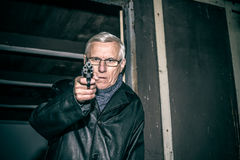 Dangerous senior aiming a gun Royalty Free Stock Image