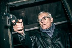 Dangerous senior with a gun Royalty Free Stock Photography