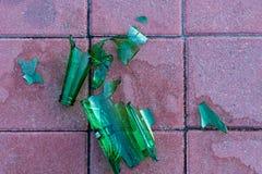 Dangerous shards of glass. Broken bottle on the sidewalk Royalty Free Stock Images