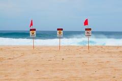 Dangerous Shore Break. Warning signs mark where there is a very dangerous shore break and rip current along the north shore of Oahu Hawaii Royalty Free Stock Photo