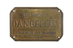 Dangerous sign. Copper plate sign: This animal is dangerous, please do not feed or disturb Royalty Free Stock Photos