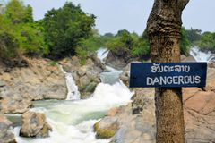 Dangerous sign at Somphamit waterfall, Mekong Stock Image