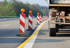 Dangerous situation. Truck driving through road works Royalty Free Stock Images