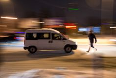 Dangerous situation on city roads in winter time. At night. Intentional motion blur royalty free stock images