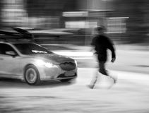 Dangerous situation on city roads. In winter time. Intentional motion blur royalty free stock photo