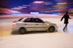 Dangerous situation on city roads. In winter time at night. Intentional motion blur stock image