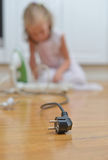 Dangerous situation at home. Child playing with electricity stock images
