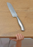 Dangerous situation in the kitchen. Child is trying to get a kitchen knife Stock Images