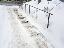 Dangerous slippery stairs and old handrail in winter. Dangerous slippery stairs and old handrail in the winter in the snow stock photography