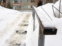 Dangerous slippery stairs and old handrail in winter. Dangerous slippery stairs and old handrail in the winter in the snow stock image