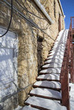 Dangerous snow covered outside stairway royalty free stock photo