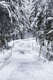 Dangerous snow covered slope of mountain route Royalty Free Stock Photography