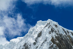 Dangerous snow mountain in clouds Royalty Free Stock Photos