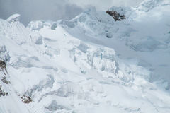 Dangerous snow mountain slope Stock Images