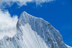 Dangerous snow peak Stock Images