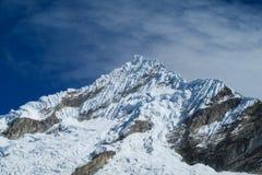 Dangerous snow and rocky peak Stock Image