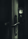 Dangerous Stranger Behind The Door. Conceptual composition about safeness, somebody unknown is behind the door Stock Image