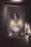 Dangerous Stranger Behind The Door. Conceptual composition about safeness, somebody unknown is behind the door Royalty Free Stock Image