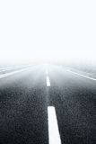 Dangerous street with heavy fog Stock Images