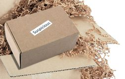A Suspicious and Dangerous Package Just Being Opened royalty free stock photo
