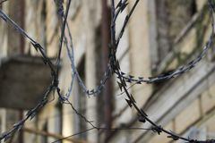 Dangerous territory with barbed wire fence around stock photography