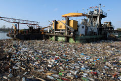 Dangerous toxic garbage. Dangerous industrial toxic garbage floating in river with other pollute waste Stock Images