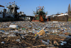 Dangerous toxic garbage. And other pollute waste floating on water Stock Images