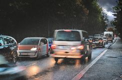 Free Dangerous Traffic In Autumn, Rush Hour With Braking Cars In The Rain On Wet Asphalt In A Narrow Street On The Way To Business Work Stock Photo - 161391730