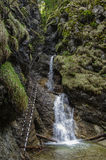 Dangerous trail across waterfall (using Via Ferrata), Slovak P. Aradise National Park,Slovakia royalty free stock photo
