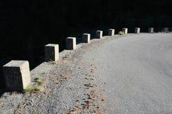 Dangerous turn of the mountain road Stock Photos