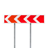 Dangerous turn. Red and white stripped arrow Royalty Free Stock Photos