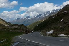 Dangerous turned road high in the Alps between melting snow Stock Photography
