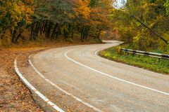 Dangerous turns in the mountains, photography. In the autumn stock images