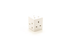 UK Plug Cube that is dangerous and unsafe. Dangerous UK Plug cube for plugging multiple three pin plugs into one socket Stock Image
