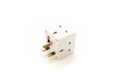 UK Plug Cube that is dangerous and unsafe. Dangerous UK Plug cube for plugging multiple three pin plugs into one socket Royalty Free Stock Photo