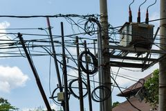 Dangerous and unsafe electricity wiring in seminyak bali indonesia on 11th december 2018. A very Dangerous and unsafe electricity wiring in seminyak bali stock photo