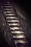 Dangerous vintage staircase. On stone wall royalty free stock image
