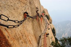 Dangerous walkway at top of holy Mount Hua Shan Stock Photo