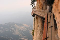 Dangerous walkway at top of holy Mount Hua Shan Stock Images