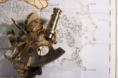 Dangerous waters. An old sextant on a very early 20th Century map of the waters around the Channel Islands royalty free stock photo