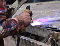 Dangerous welding without protective work wear Royalty Free Stock Photography